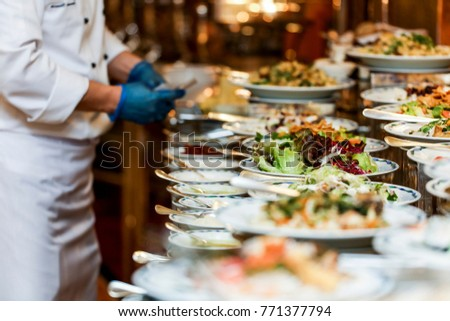 Chef arranging food on buffet table stock photo edit now 771377794 chef is arranging the food on buffet table watchthetrailerfo
