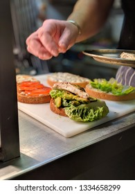 Chef assembling Chicken Club Sandwich in Gourmet Restaurant