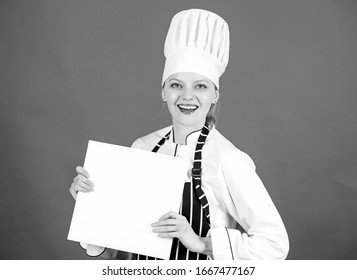 Chef author culinary book. Cooking food and culinary as hobby. Cook looking for cooking recipe in cookbook. Woman reading cook book in kitchen. Tips and advice. Cooking food. Delicious and gourmet.