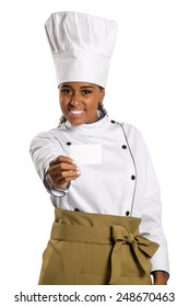 Chef, baker or cook woman showing blank sign card wearing chefs uniform and hat. Blank card for menu, gift card, offer etc Beautiful african / black female isolated on white background