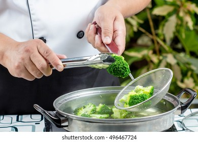 chef boiled broccoli in pot