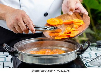 chef boiled carrots in pot