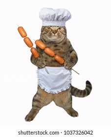The chef cat holds the sausages on the barbecue wooden skewers. White background.