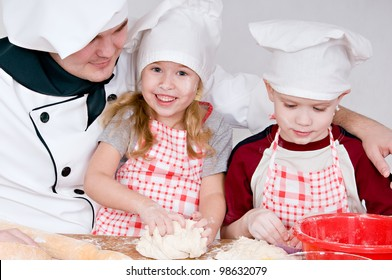 chef and children in the chefs prepare a meal