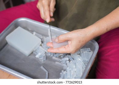 Chef chopping a gelatin on stainless tray