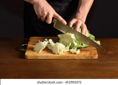 chef chopping a lettuce