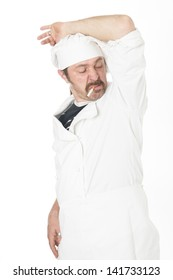 chef with cigarette smells his armpit isolated on white background