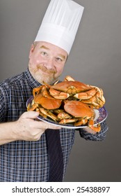 Chef with Cooked Dungeness Crabs