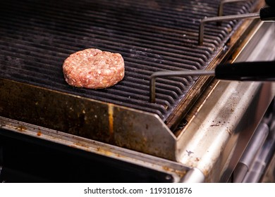 Chef cooking burger on grill restaurant .Skilled chef