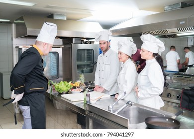 Chef Cooking, Cutting and preparing next plate
