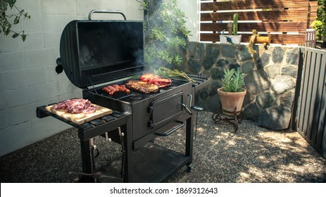 Chef cooking a delicious pork ribs with red peppers on the BBQ grill. Cook pork meat on grilled meat. Food cooked with grilling barbecue in backyard of house