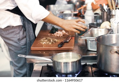 chef cooking food in kitchen, Chef preparing food, meal, cooking cutting fresh vegetables