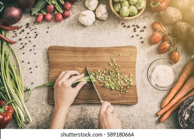 chef cooking food kitchen restaurant cutting prepare cook hands healthy hotel man male knife preparation fresh preparing young natural culinary domestic desktop dietary red concept - stock image