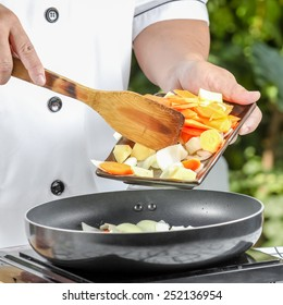 chef cooking for fried pork and vegetable in kitchen outdoor