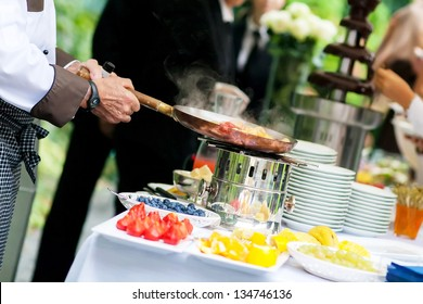 chef is cooking fruit