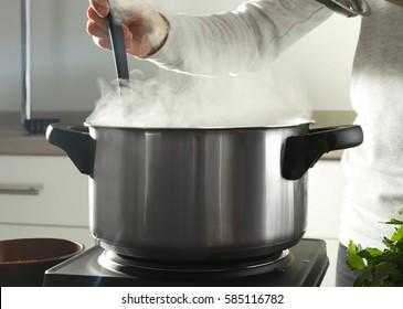 Chef cooking tasty dish in kitchen
