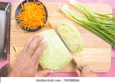 Chef cutting cabbage on wooden broad / Cooking Yakisoba concept