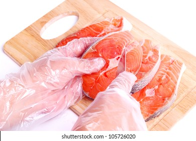 Chef cutting fresh salmon on the board