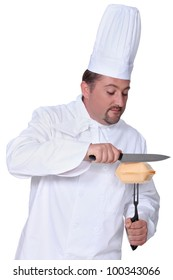 Chef cutting open a burger box