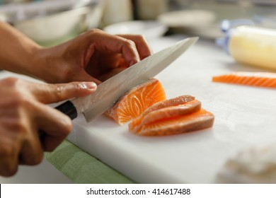 Chef Cutting Salmon for Making Sashimi
