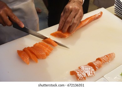 Chef cutting salmon slice fish