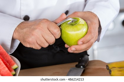 Chef cutting a sour apple green