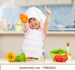 Chef girl preparing healthy food in domestic kitchen