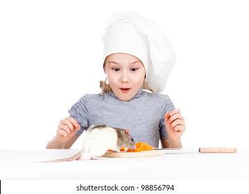 Chef girl preparing healthy food. Helper rat are sitting near.