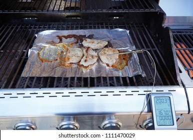 Chef grilling porkchops on the grill, slow cooking and the right spices make for a very tasty meal