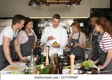 Chef and group of young people during cooking classes