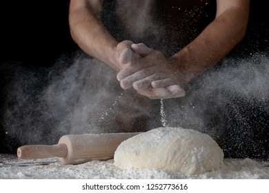 Chef hands cooking dough on dark wooden background. Food concept