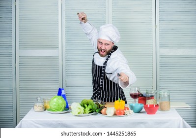 Chef hold cleaver knife tool ready to chop ingredients. Man wear apron cooking in kitchen. Man use sharp cleaver knife. Types of knives. Sharp knife professional tool. Chef choose professional tools.