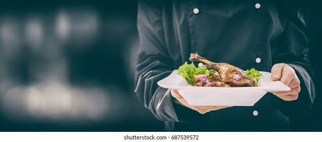 The chef keeps perfect made dinner. chef cooking restaurant food dish dine fine plate background serve hotel garnish gourmet molecular backdrop prepare culinary concept - stock image