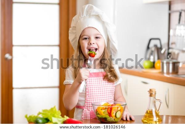 Chef kid tasting healthy food