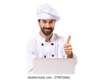 Chef with laptop over isolated white background