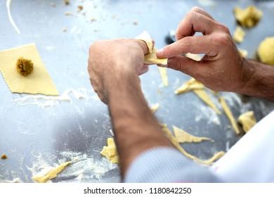 chef make Homemade raw Italian tortellini