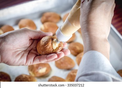 chef making homemade bakery name is choux cream