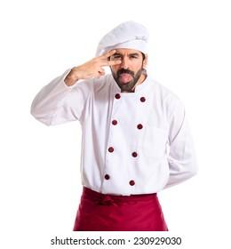 Chef making a joke over white background