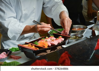 Chef making kobe sushi on boat, japanese wagyu beef sushi