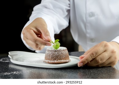 chef making lava chocolate cake in the kitchen