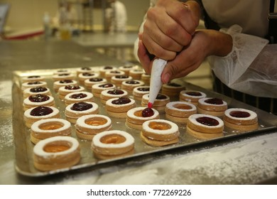Chef making 'Mini Tartlets' on the bakery shop table.