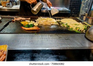 Chef making Okonomiyaki in Kyoto Japan