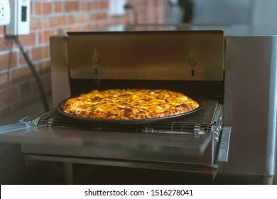 chef making pizza at kitchen