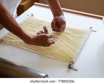 Chef making raw udon japanese noodle