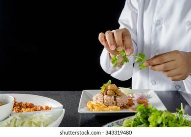 chef making thai cuisine, Rice Mixed with Shrimp paste in restaurant