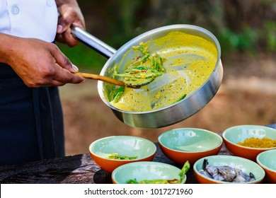 Chef making traditional Sri Lankan curry dish at cooking class