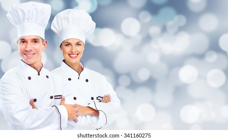 Chef man and woman over abstract lights background.