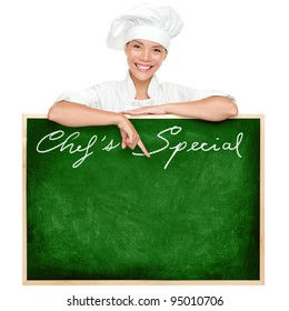 Chef menu sign blackboard copy space. Woman chef holding showing blank chefs special restaurant menu chalkboard isolated on white background. Multiracial Chinese Asian / Caucasian female cook chef