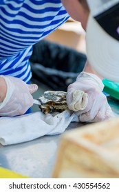 Chef opens the oyster with special knife