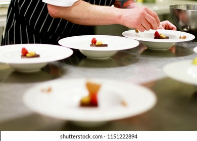 chef plating chocolate dessert